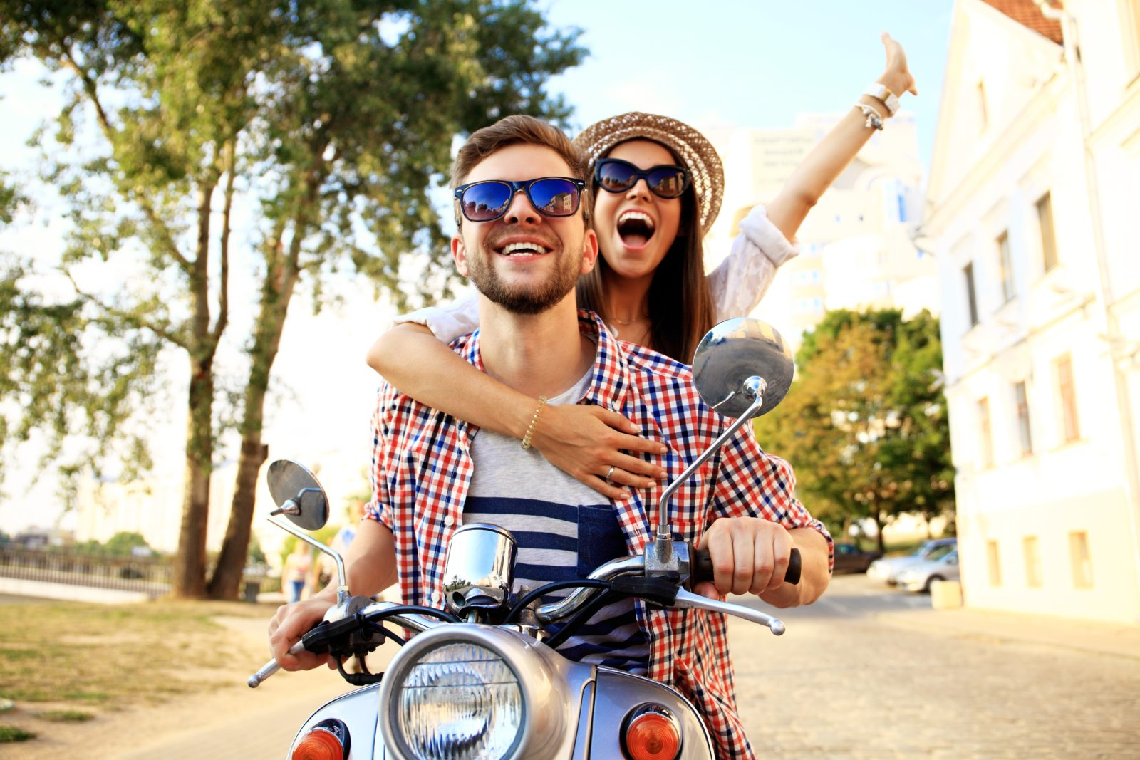 Young Happy Couple on a Motorcycle