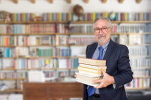 Scholar Holding Books