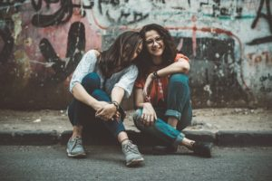 acceptance displayed through 2 girls laughing together